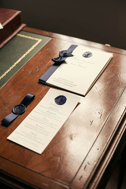 Stationary in precious white paper with a dark blue hand made wax seal and blue ribbon