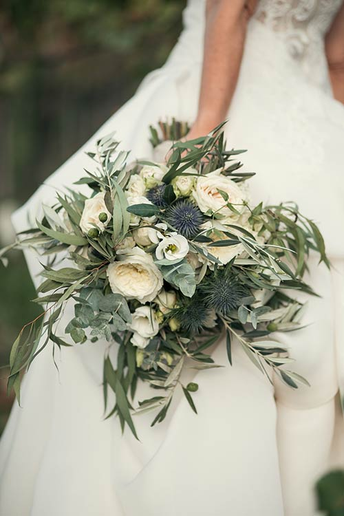 Country chic bouquet made up of olive leaves and white flowers