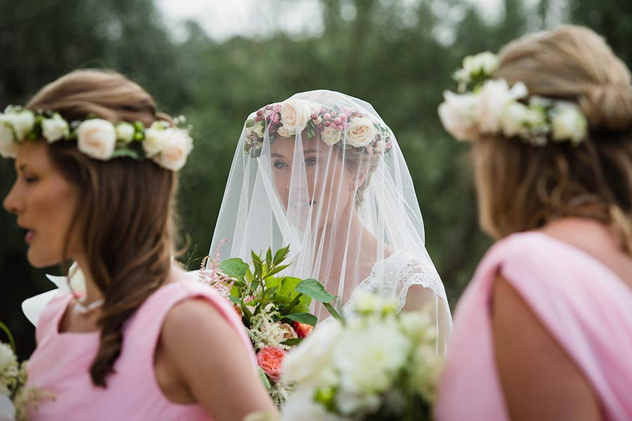 The bride was radiant among her ladies in faint pink