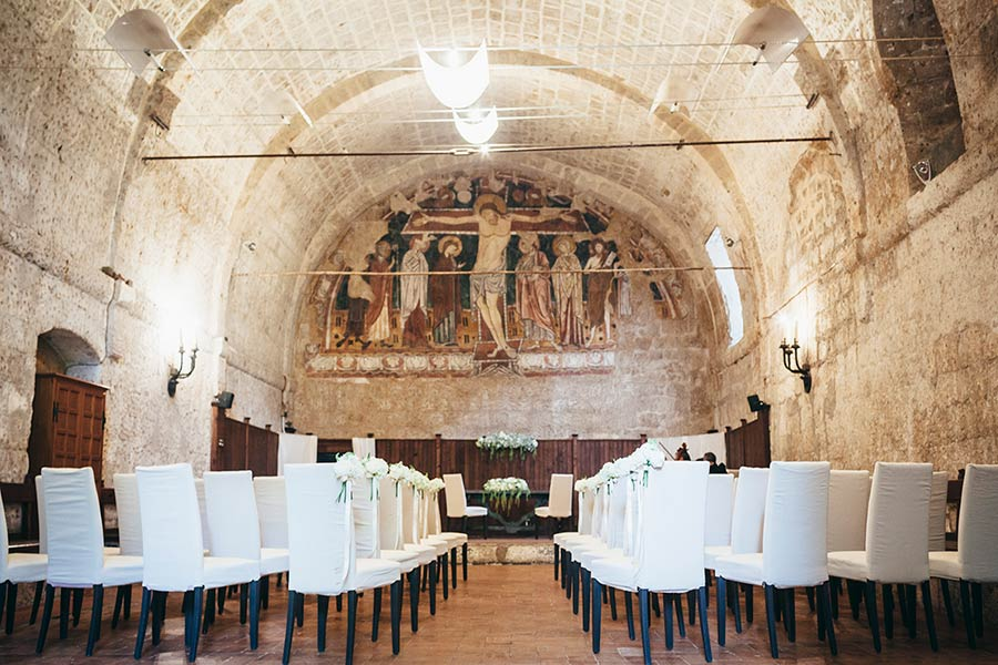 Wedding ceremony in the former refectory of the abbey under a beautiful fresco