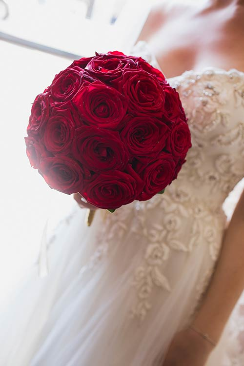 Bridal bouquet was a splendid and perfect sphere of red roses