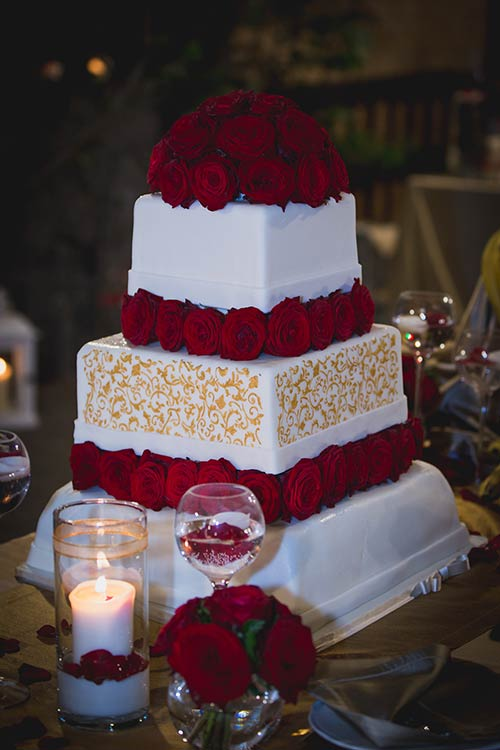 Wedding cake was white and red perfectly following the theme of the wedding