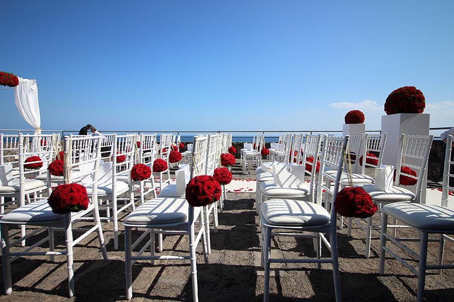 Legal civil ceremony at Norman Castle terrace overlooking the sea