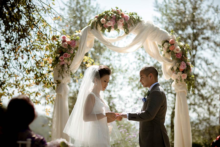 Decoration was made of floral arch with pink and cream flowers with a soft cream fabric
