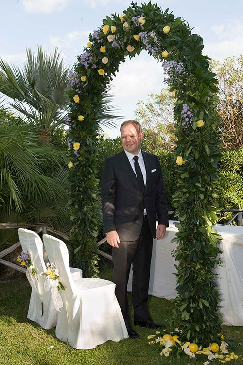 Konrad under the ceremony's floral arch