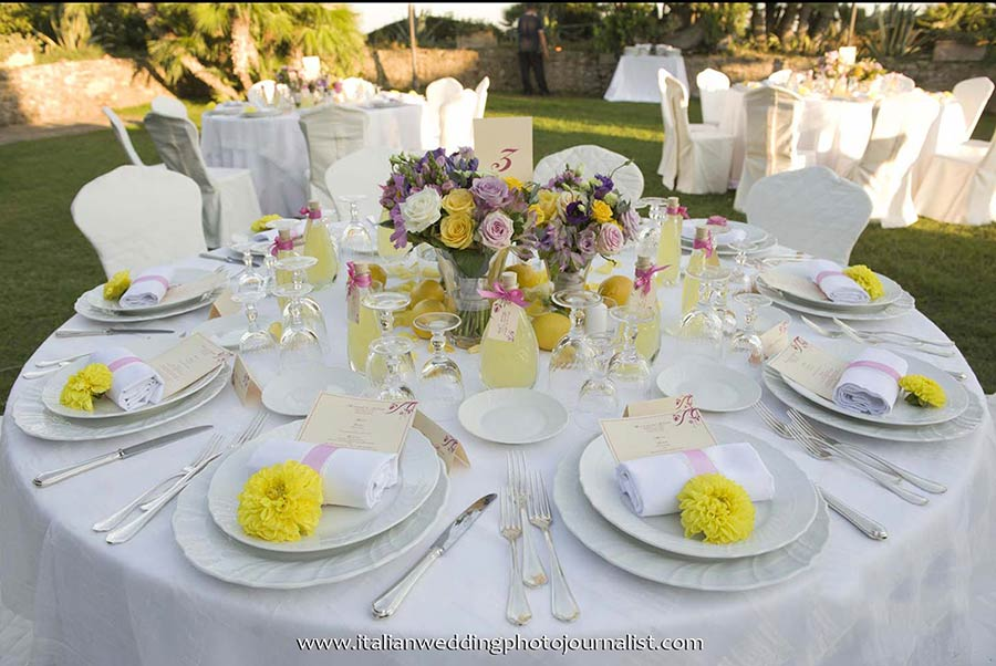 The table set up was a mixture of bright flower colors with yellow lemons and a bottle of Limoncello liquor