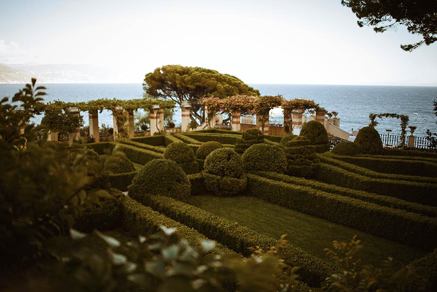 Wedding ceremony was planned in the Italian garden overlooking the sea