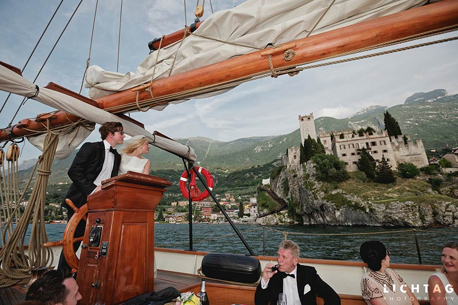 Sailing on Lake Garda in front at Malcesine Castle